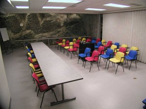 Multipurpose room with a beautiful, natural rock wall